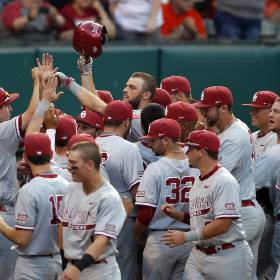 OU\'s Cody Thomas, center, celebrates a home run in the fourth inning during the Bedlam baseball...