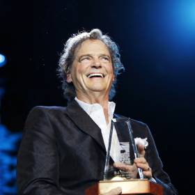 B.J. Thomas, a Hugo native, smiles after being surprised with an induction into the Oklahoma Music Hall of Fame during his concert at Riverwind Casino's Showplace Theatre in Norman, Okla., Thursday, April 28, 2016. The Grammy winner is known for singing such hits as