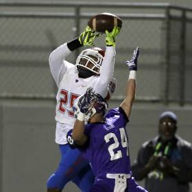 John Marshall\'s Justin Broiles makes a catch over Bethany\'s Evan Brinegar during the high...