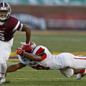 Mustang's Deontre Thomas, shown here diving for Edmond Memorial running back Warren Wand during a 2014 game, says he will announce his college decision Saturday on Twitter. [Photo by Bryan Terry, The Oklahoman]