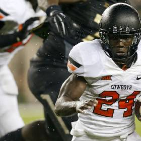 Oklahoma State's Tyreek Hill (24) carries the ball during a college football game between the Oklahoma State University Cowboys (OSU) and the Baylor Bears at McLane Stadium in Waco, Texas, Saturday, Nov. 22, 2014. Baylor won, 49-28. Photo by Nate Billings, The Oklahoman