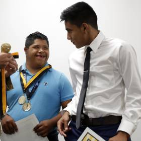 Santa Fe South's Jesus Andrade, right, and Clinton's Fermin Galvin are given awards during Santa Fe South's spring sports awards ceremony at Western Hills Church. Photo by Sarah Phipps, The Oklahoman  Sarah PhIpps - Sarah Phipps