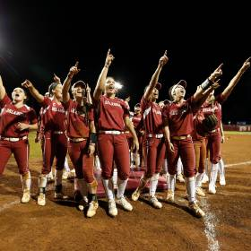 University of Oklahoma Sooner (OU) players celebrate after they defeat the Louisiana-Lafayette...