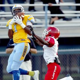 Putnam City West\'s Nick Robinson catches a touchdown as Lawton\'s Jiar Thomas defends during...
