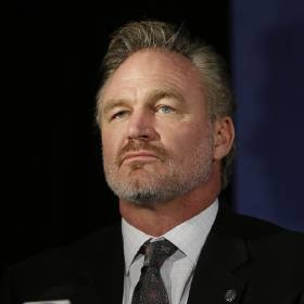 FILE - In this Jan. 9, 2015, file photo, former Oklahoma linebacker Brian Bosworth listens during a news conference announcing the 2015 College Football Hall of Fame Class, in Dallas. Bosworth's College Football Hall of Fame induction was a milestone that marked a turning point in the life of the former Oklahoma linebacker known as the Boz. (AP Photo/LM Otero, File)