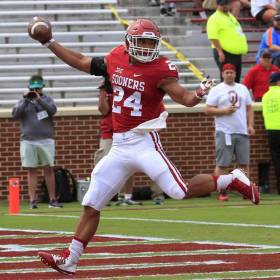 Running back Rodney Anderson celebrates a touchdown during Saturday's OU spring game in Norman. [Photo by Steve Sisney, The Oklahoman]