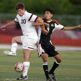 Edmond Memorial's Baxton Pickard and Putnam City's Irra Jose fight for a ball during the boys high school soccer playoff between Putnam City and Edmond Memorial at Edmond Memorial High School in Edmond, Okla., Tuesday, May 3, 2016. Photo by Sarah Phipps, The Oklahoman