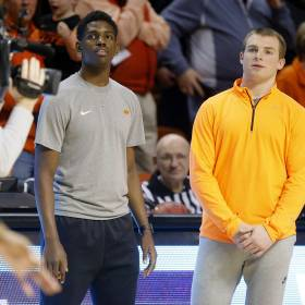 Oklahoma State's Jawun Evans and Phil Forte watch during warm up before a college basketball game between the Oklahoma State Cowboys (OSU) and the Iowa State Cyclones (ISU) at Gallagher-Iba Arena in Stillwater, Okla., Saturday, Feb. 6, 2016. OSU lost 59-64. Photo by Bryan Terry, The Oklahoman