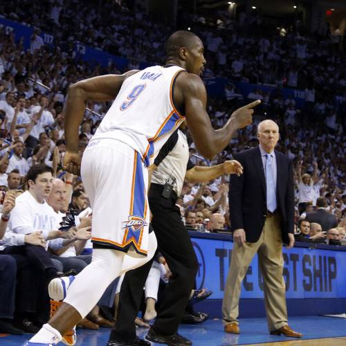 Oklahoma City's Serge Ibaka (9) celebrates during Game 6 of the Western Conference Finals in the NBA playoffs between the Oklahoma City Thunder and the San Antonio Spurs at Chesapeake Energy Arena in Oklahoma City, Saturday, May 31, 2014. Photo by Bryan Terry, The Oklahoman