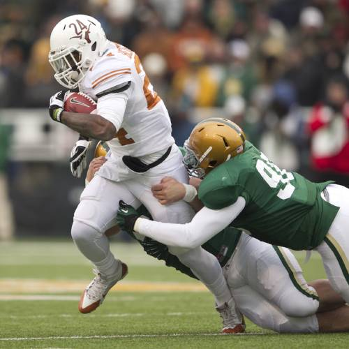 UT running back Joe Bergeron is tackled by Baylor defenders Trevor Clemmons-Valdez and Byron Bonds in the first quarter at Floyd Casey Stadium in Waco on Saturday December 7, 2013. JAY JANNER / AMERICAN-STATESMAN