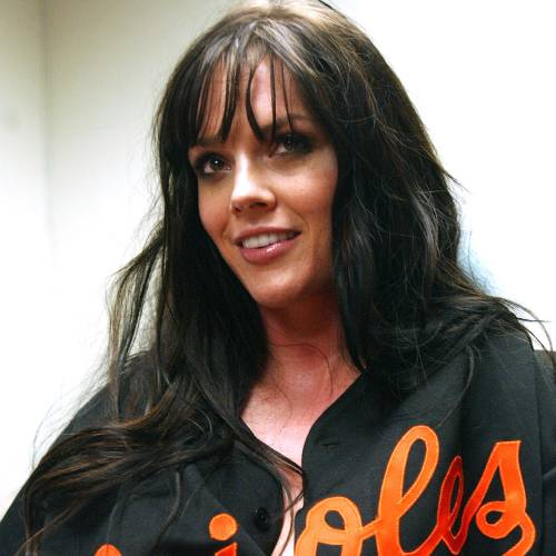 Anna Benson, the wife of Orioles pitcher Kris Benson, reacts to questions from the media, in this Jan. 21, 2006 file photo in New York. Anna Benson could find herself getting plenty of face time on ESPN in the coming year. Not during baseball games, but more likely during one of the network's ubiquitous poker broadcasts. Benson has been polishing her game by playing nearly every day, whether online, on her cell phone or even live and in person. She also recently signed a deal to endorse and promote a fledgling poker Web site. (AP Photo/Jennifer Szymaszek)