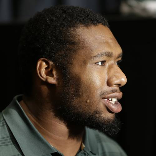 Baylor defensive end Shawn Oakman speaks to reported during the NCAA college Big 12 Conference Football Media Days in Dallas, Monday, July 21, 2014. (AP Photo/LM Otero)