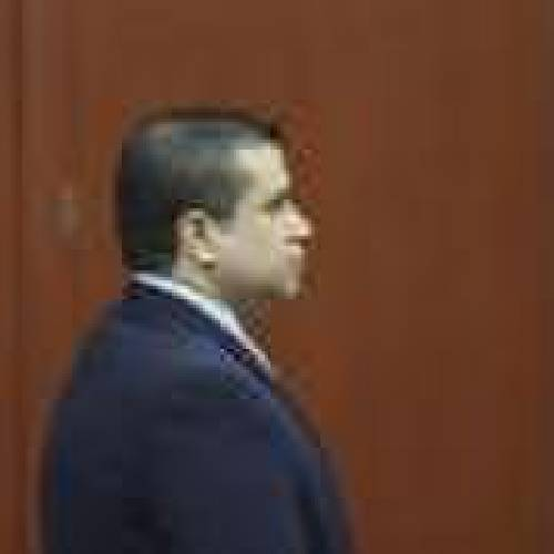 George Zimmerman stands alone at the defense table moments after the jury left the courtroom to deliberate during his trial in Seminole circuit court in Sanford, Florida July 12, 2013. REUTERS/Gary W. Green/Pool