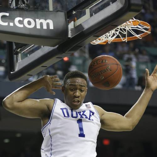 Duke's Jabari Parker (1) dunks against Clemson during the first half of a quarterfinal NCAA college basketball game at the Atlantic Coast Conference tournament in Greensboro, N.C., Friday, March 14, 2014. (AP Photo/Gerry Broome)