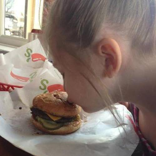 "Anna Kaye MacLean posted this photo on Chili's national Facebook page. This happened Sunday, March 25, 2013, at the Chili's in Midvale. Arianna, who has an autism spectrum disorder, would not eat her cheeseburger because it was ""broken."" It was cut in half according to restaurant policy. Lauren Wells, her waitress, ordered a new burger, uncut. This is Arianna's reaction when she saw it."