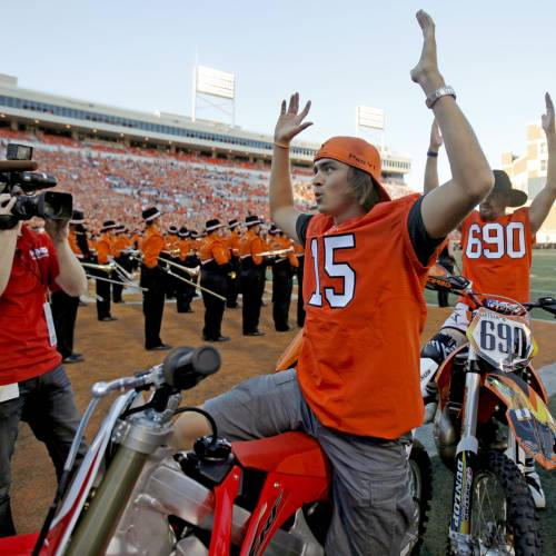 Former OSU golfer Rickie Fowler acknowledges the crowd before a college football game between the Oklahoma State University Cowboys (OSU) and the University of Arizona Wildcats at Boone Pickens Stadium in Stillwater, Okla., Thursday, Sept. 8, 2011. Photo by Bryan Terry, The Oklahoman ORG XMIT: KOD