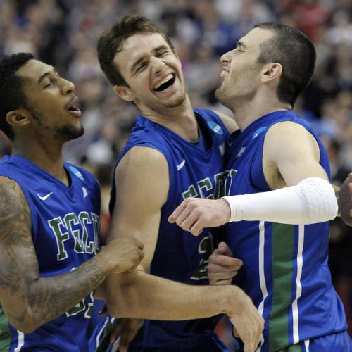 Florida Gulf Coast's Dajuan Graf, from left, Eddie Murray and Brett Comer celebrate after winning a third-round game against San Diego State in the NCAA college basketball tournament, Sunday, March 24, 2013, in Philadelphia. Florida Gulf Coast won 81-71. (AP Photo/Michael Perez) ORG XMIT: PXC120