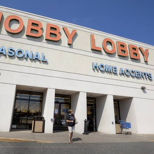 FILE - In this Sept. 12, 2012 file photo, a woman walks from a Hobby Lobby Inc., store in Little Rock, Ark. Christian pastors plan to deliver petitions to Hobby Lobby officials in protest of the Oklahoma-based companyÂ's lawsuit challenging health care guidelines that require the coverage of the morning-after pill. (AP Photo/Danny Johnston, File)