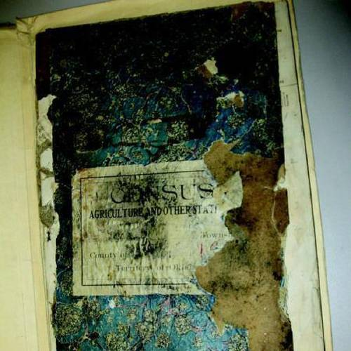 These volumes of againg census records for Payne County are in jeopardy because of mold. (Stillwater NewsPress photo)