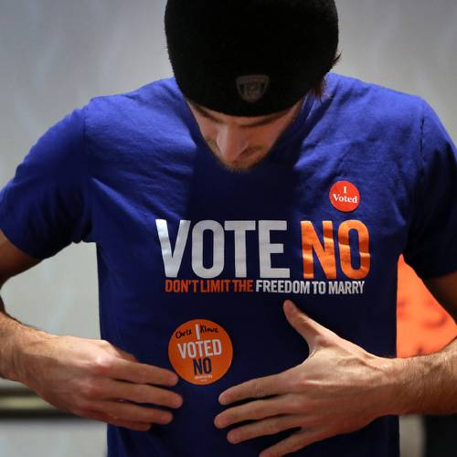 """Minnesota Vikings NFL football punter Chris Kluwe joins volunteers from Minnesotans United for All Families at the University of Minnesota to encourage voters to register a """"No"""" vote on the marriage amendment, Tuesday, Nov. 6, 2012, in Minneapolis. (AP Photo/Star Tribune, Jim Gehrz)"""