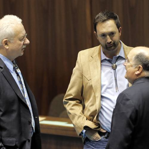 Arizona State Rep's Adam Kwasman, R-Oro Valley, center, John Kavanaugh, R-Fountain Hills, left, and John Allen, R-Scottsdale, speak during a special session for Medicaid funding on Thursday, June 13, 2013, in Phoenix. (AP Photo/Matt York)