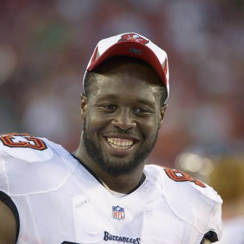 Tampa Bay Buccaneers defensive tackle Gerald McCoy (93) has a laugh on the sideline during the first half of an NFL preseason football game against the Baltimore Ravens in Tampa, Fla., Thursday, Aug. 8, 2013. (AP Photo/Phelan M. Ebenhack)