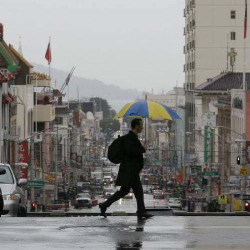 A man crosses Stockton Street in San Francisco, Wednesday, Feb. 26. Photo by Jeff Chiu / AP
