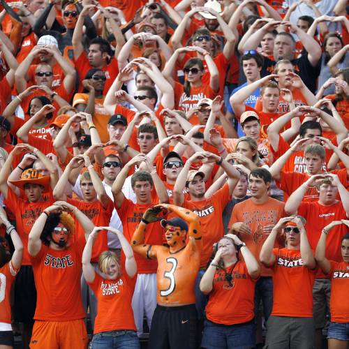 CROWD: OSU fans cheer during the college football game between the University of Tulsa (TU) and Oklahoma State University (OSU) at Boone Pickens Stadium in Stillwater, Oklahoma, Saturday, September 18, 2010. Photo by Sarah Phipps, The Oklahoman ORG XMIT: KOD