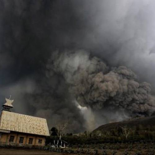 Image #: 26929813 epa04050621 Mounth Sinabung spews volcanic materials in Karo, North Sumatra, Indonesia, 01 February 2014. At least 14 people were killed when a volcano on the Indonesian island of Sumatra spewed lava and hot gas, an aid worker said. The eruption of Mount Sinabung came a day after the National Disaster Management Agency said residents living farther than 5 kilometres from the peak were being allowed to return to their homes after a lull in activity. EPA/CHAIRALY /LANDOV