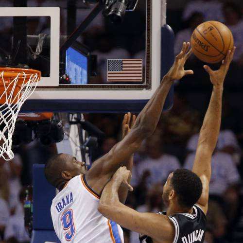 Oklahoma City's Serge Ibaka (9) defends against San Antonio's Tim Duncan (21) during Game 6 in the first round of the NBA playoffs between the Oklahoma City Thunder and the Memphis Grizzlies at FedExForum in Memphis, Tenn., Thursday, May 1, 2014. Photo by Bryan Terry, The Oklahoman