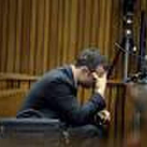 Olympic and Paralympic track star Oscar Pistorius reacts during a testimony at the North Gauteng High Court in Pretoria March 10, 2014. Pistorius is on trial for murdering his girlfriend Reeva Steenkamp at his suburban Pretoria home on Valentine's Day last year. REUTERS/Bongiwe Mchunu/Pool (SOUTH AFRICA - Tags: SPORT ATHLETICS CRIME LAW)