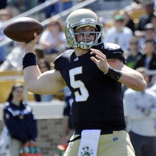 FILE - In this April 21, 2012, file photo, Notre Dame quarterback Gunner Kiel throws a pass during the Blue Gold spring NCAA college football game in South Bend, Ind. Notre Dame coach Brian Kelly announced Tuesday, March 21, 2013m that the former standout from Columbus, Ind., who was one of the top-rated quarterbacks coming out of high school a year ago, plans to transfer. (AP Photo/Joe Raymond, File) ORG XMIT: NY166