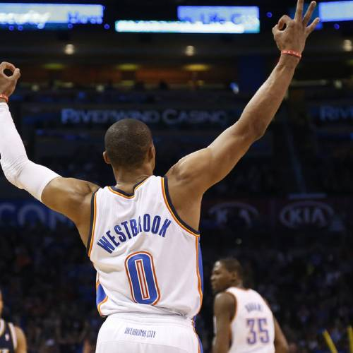 Oklahoma City Thunder guard Russell Westbrook (0) signals a three-point basket by teammate Kevin Durant (35) in the first quarter of an NBA basketball game against the Utah Jazz in Oklahoma City, Sunday, March 30, 2014. (AP Photo/Sue Ogrocki)