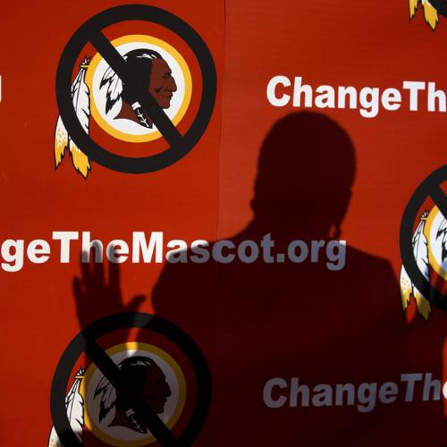 "The shadow of Del. Eleanor Holmes Norton, D-D.C., is cast on the backdrop during the Oneida Indian Nation's Change the Mascot symposium, Monday, Oct. 7, 2013, in Washington, calling for the Washington Redskins NFL football team to change its name. During an interview, President Barack Obama suggested that the owner of the Washington Redskins football team consider changing its name because, the president said, the current name offends ""a sizable group of people."" (AP Photo/Carolyn Kaster)"