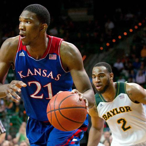 WACO, TX - FEBRUARY 04: Joel Embiid #21 of the Kansas Jayhawks drives to the basket against the Baylor Bears on February 4, 2014 at the Ferrell Center in Waco, Texas. (Photo by Cooper Neill/Getty Images)