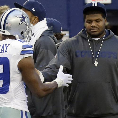 Dallas Cowboys suspended player Josh Brent, right, is greeted by DeMarco Murray (29) on the sideline during the first half of an NFL football game against the Pittsburgh Steelers Sunday, Dec. 16, 2012 in Arlington, Texas. Brent was the driver in a car crash that killed teammate Jerry Brown, Jr.(AP Photo/LM Otero)
