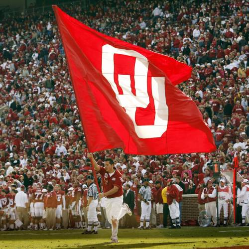 The OU flag is carried accross the field after a touchdown during the second half of the college football game between The University of Oklahoma Sooners (OU) and the Baylor Bears at the Gaylord Family-Oklahoma Memeorial Stadium on Saturday, Oct. 10, 2009, in Norman, Okla. Photo by Steve Sisney