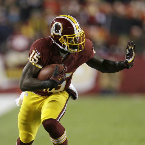 """In this Dec. 1, 2013, photo, Washington Redskins wide receiver Josh Morgan runs with the ball during an NFL football game against the New York Giants in Landover, Md. Morgan, who recently agreed to a contract with the Chicago Bears, has been arrested and charged with punching a man outside a Washington nightclub. D.C. police spokesman Officer Paul Metcalf confirmed Monday night, April 28, 2014, that a man named Josh Morgan was arrested early Sunday and charged with simple assault, a misdemeanor. The Bears say they are aware of """"Josh Morgan's presence at a weekend incident in Washington, D.C.,"""" and are gathering information. (AP Photo/Patrick Semansky)"""