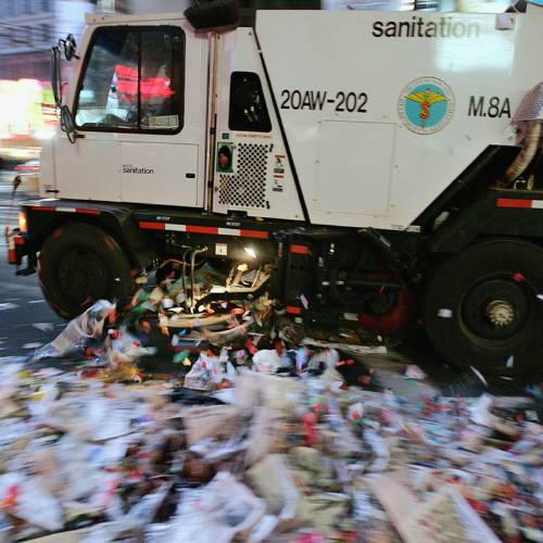 NEW YORK - JANUARY 1: A New York City Sanitation truck cleans up some of the tons of trash left by the revelers attending the New Years celebration January 1, 2005 in Times Square in New York City. Close to 1 million people welcomed 2005 at the Times Square festivities.(Photo by Stephen Chernin/Getty Images)