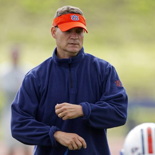 Auburn University coach Gene Chizik talks with linebacker Jonathan Evans during the first day of spring NCAA college football practice for the national champion Auburn Tigers in Auburn, Ala., Wednesday, March 23, 2011. (AP Photo/Dave Martin) ORG XMIT: ALDM109