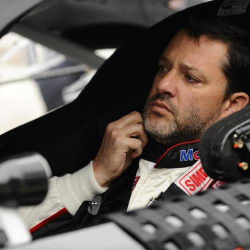 Tony Stewart prepares to start the NASCAR Sprint Cup series auto race at Texas Motor Speedway Monday, April 7, 2014, in Fort Worth, Texas. Stewart starts on the pole in the race which was postponed a day because of rain. (AP Photo/Ralph Lauer)