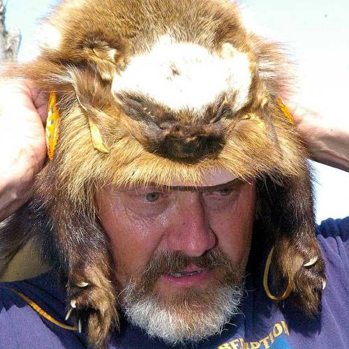 Kevin Martin shows one of the hats he made from animal skins. (Lawton Constitution photo)