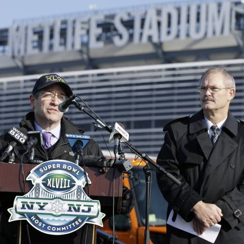 President and CEO of MetLife stadium, Brad Mayne, right, listens as Frank Supovitz, left, senior vice president of events for the National Football League, answers a question at MetLife stadium in East Rutherford, N.J., Wednesday, Dec. 18, 2013, as officials demonstrated snow removal and melting machinery and outlined emergency weather scenarios and contingency plans for the Super Bowl in February. (AP Photo/Mel Evans)