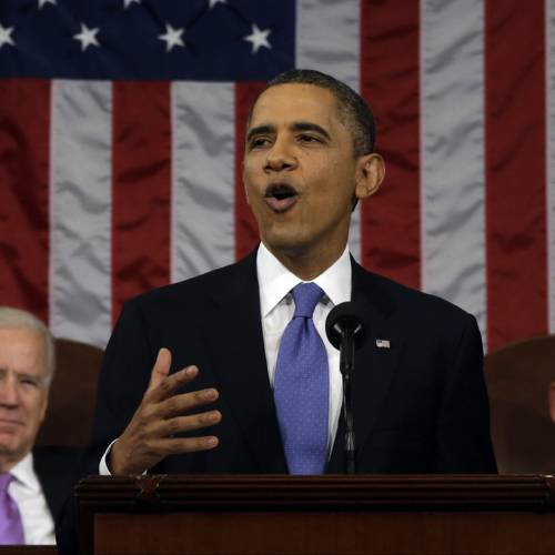 President Barack Obama, flanked by Vice President Joe Biden and House Speaker John Boehner of Ohio, gestures as he gives his State of the Union address during a joint session of Congress on Capitol Hill in Washington, Tuesday Feb. 12, 2013. (AP Photo/Charles Dharapak, Pool)