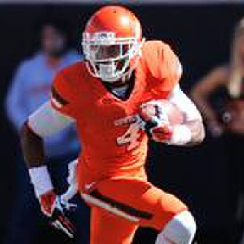 Oklahoma State's Justin Gilbert carries in the second quarter of an NCAA college football game against TCU in Stillwater, Okla., Saturday, Oct. 19, 2013. (AP Photo/Sue Ogrocki)