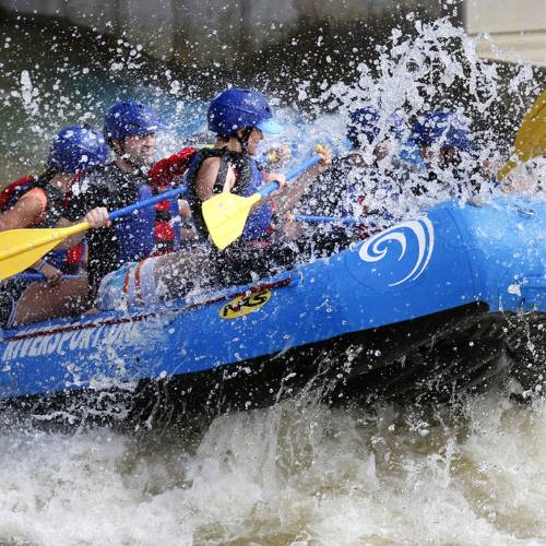 Teams compete in the RIVERSPORT Whitewater Rafting League during the Stars and Stripes River...