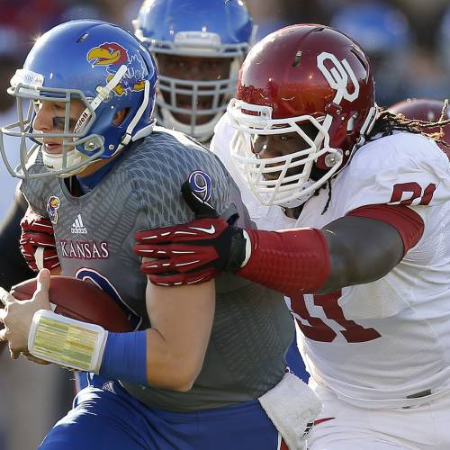 OU's Charles Tapper (91) brings down KU's Jake Heaps (9) during the college football game between the University of Oklahoma Sooners (OU) and the University of Kansas Jayhawks (KU) at Memorial Stadium in Lawrence, Kan., Saturday, Oct. 19, 2013. Oklahoma won 34-19. Photo by Bryan Terry, The Oklahoman