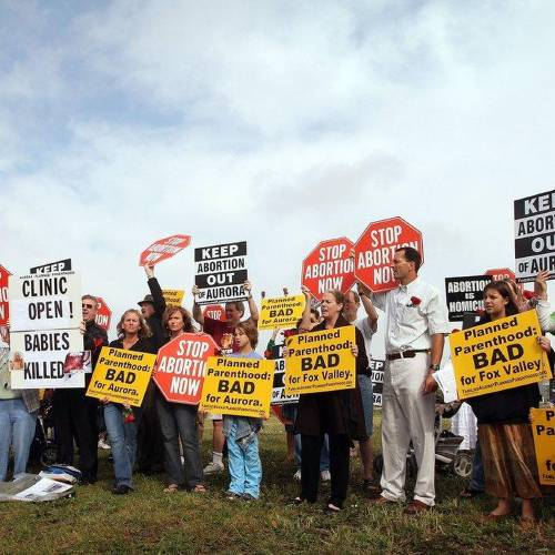 AURORA, IL - OCTOBER 02: Protestors gather for the opening of a Planned Parenthood clinic October 2, 2007 in Aurora, Illinois. The clinic, reported to be the largest Planned Parenthood clinic in the country, was scheduled to open last month but the opening was held up until today by last minute legal challenges. (Photo by Scott Olson/Getty Images)