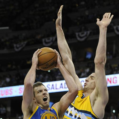 Golden State Warriors forward David Lee, left, drives the lane against Denver Nuggets center Kosta Koufos, right, in the first quarter of Game 1 in the first round of the NBA basketball playoffs on Saturday, April 20, 2013, in Denver. (AP Photo/Chris Schneider) ORG XMIT: COCS101