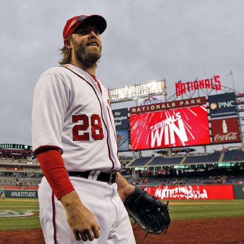 Washington Nationals right fielder Jayson Werth (28) smiles as he heads for the dugout after a baseball game against the Miami Marlins at Nationals Park, Thursday, April 4, 2013, in Washington. Werth hit a three-run home run and the Nationals won 6-1. (AP Photo/Alex Brandon) ORG XMIT: NAT115